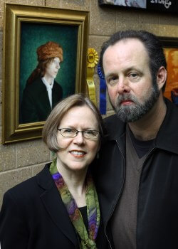 Christopher Winslow and his wife, Patricia, in front of his winning painting.