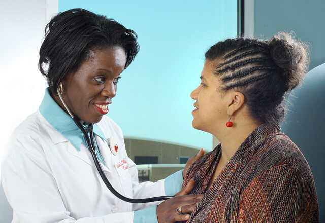Primary care physician examining a female patient