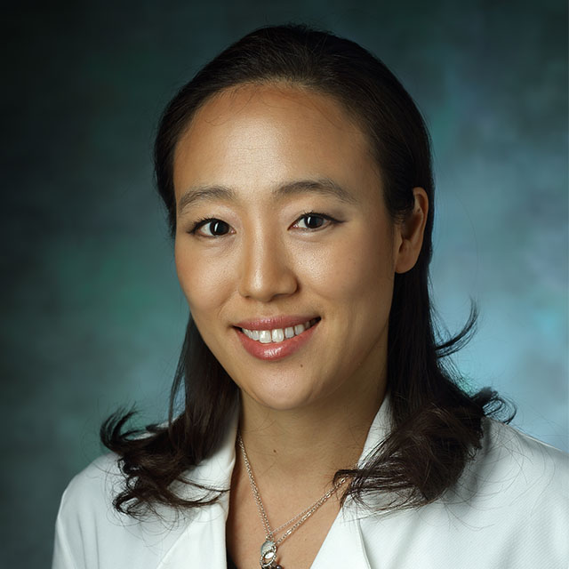 head shot of Dr. Chung, wearing a white lab coat