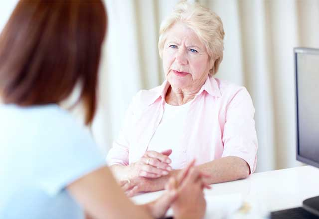 elderly woman receiving counseling