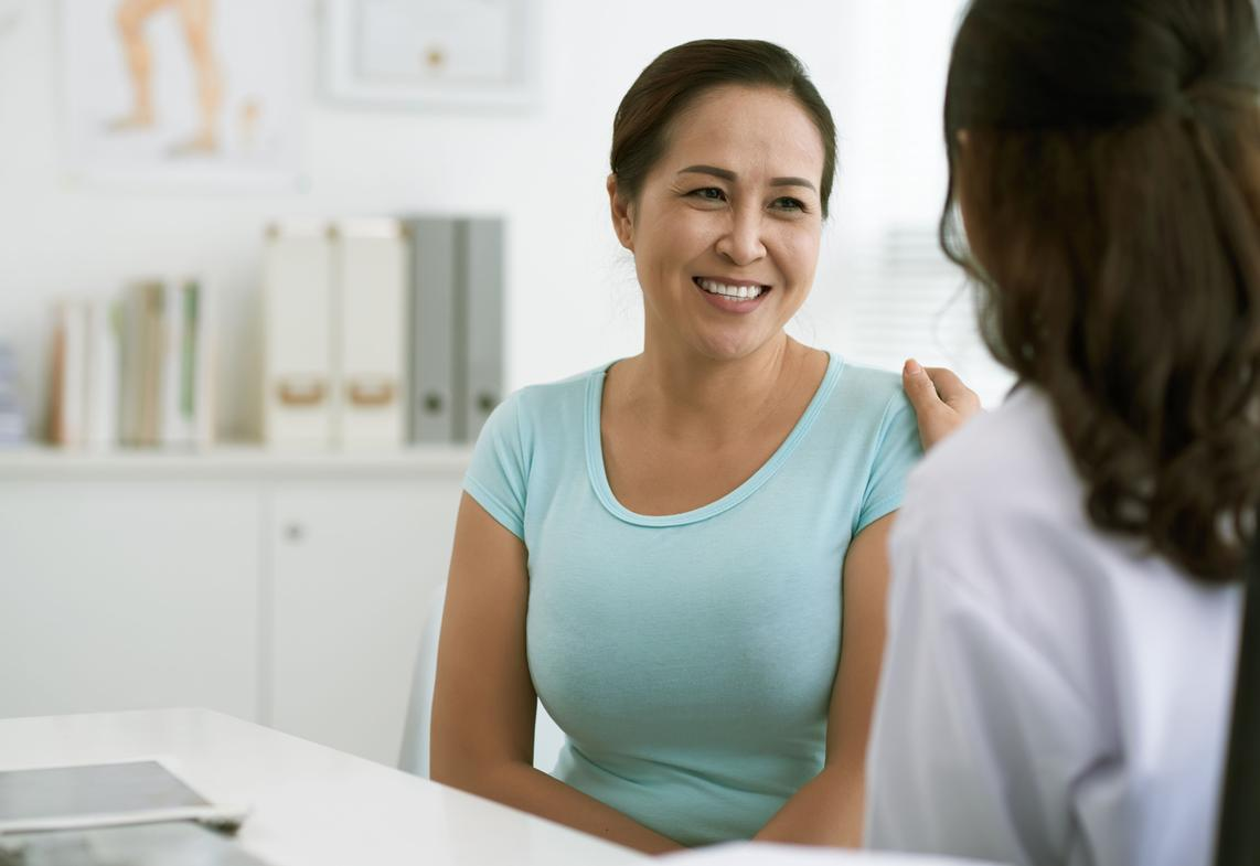 woman speaking to doctor