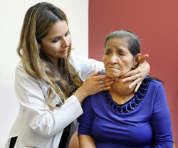 Berenice Nava examines 75-year-old Maria Portillo, who last saw a physician 15 years ago.  Thanks to TAP, Portillo was referred for surgery for removal of  her goiter.