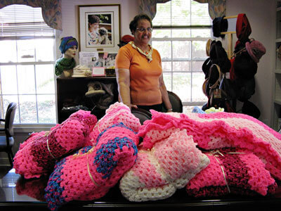 Mabel Alsobrooks with the beautiful crochet blankets she made for Claudia Mayer Cancer Resource Center clients.
