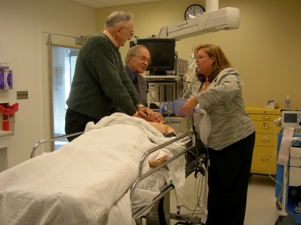 CPR Pioneers Guy Knickerbocker and James Jude with our Director, Elizabeth Hunt performing CPR on SimMan on Opening Day of the Johns Hopkins Medicine Simulation Center, March 10, 2008