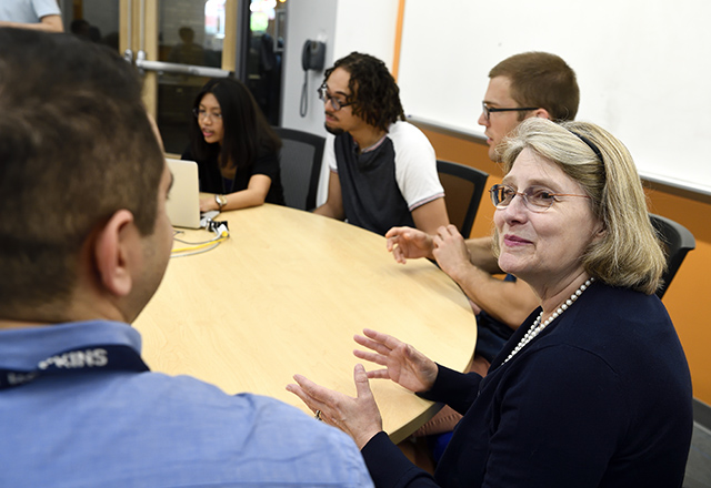Faculty speaking with graduate students