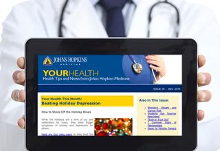Doctor holding tablet with your health newsletter on the screen