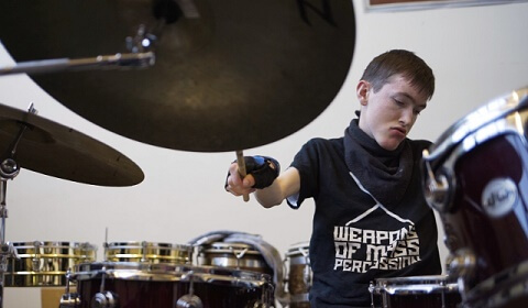 Owen playing the drums.