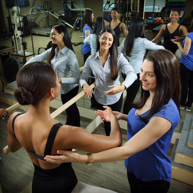 Physical therapists work with a dancer