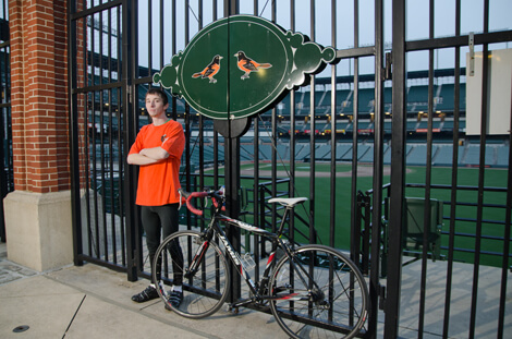 Jacob Landis is cycling to all 30 Major League Baseball stadiums in the United States and Canada to raise money to provide cochlear implants for those who can't afford them.