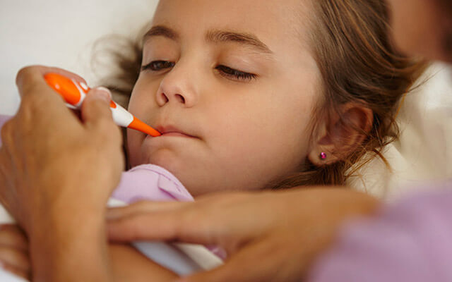 Young girl with a thermometer