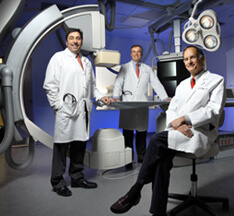 Dr. Gordon Tomaselli, Dr. Edward Kasper and Dr. Bruce Perler in one of the new cardiac catheterization laboratories of the new Johns Hopkins Hospital building.