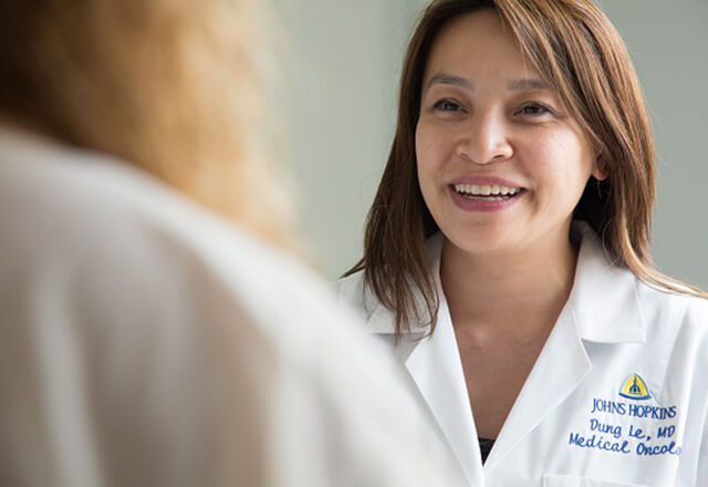 Dr. Le with a patient