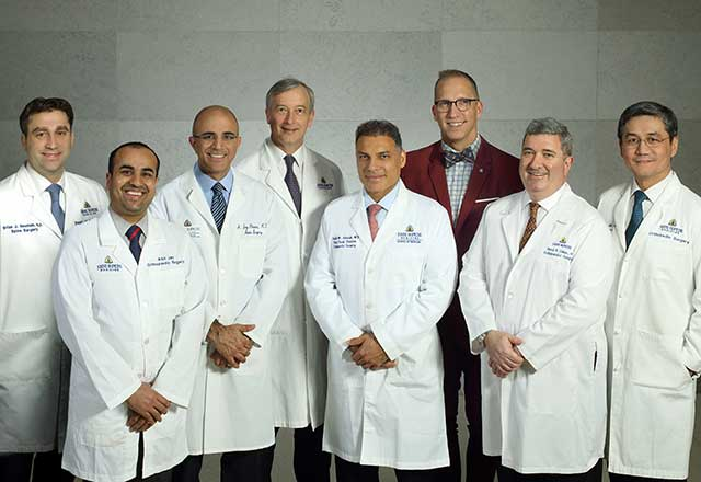 A group photo of Johns Hopkins orthopaedic spine surgeons