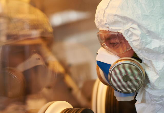 researchers in a safety mask