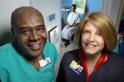 JHHS employee Willie Myers, a clinical associate in the outpatient urology clinic, and clinic supervisor Patricia Young, a JHU employee.