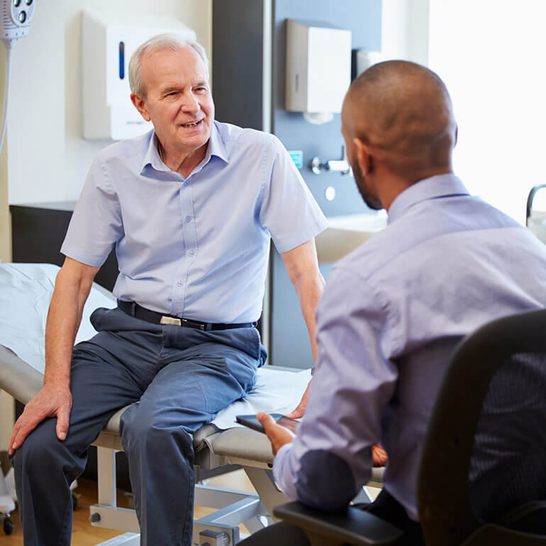 Patient speaking with his endocrinologist