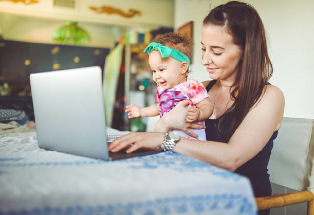 woman and infant having a televisit at home