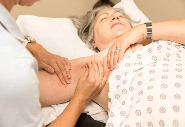 Woman being treated for lymphedema