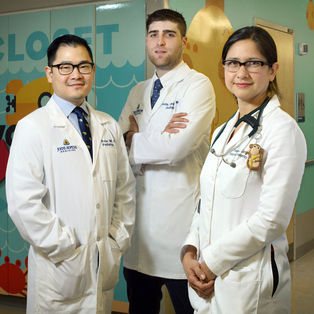 Senior residents Ted Kouo and Keith Kleinman, and pediatric emergency medicine physician Therese Canares.