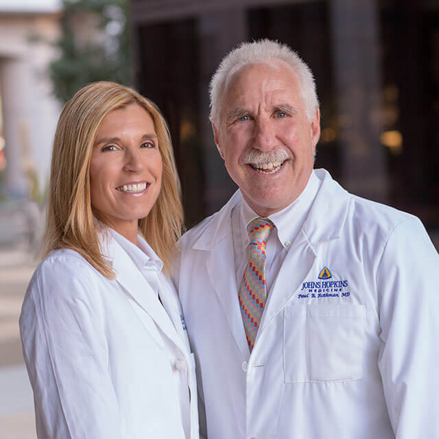 Dr. Redonda Miller and Dr. Paul Rothman smile together