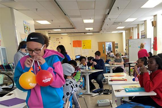 Golden Ring Middle School students replicate the respiratory system using balloons, straws and tape.