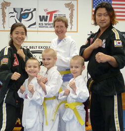 Kathy Wilson and her three sons at Tae Kwon Do class