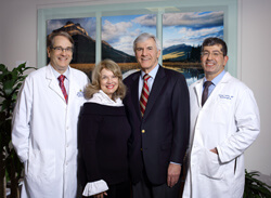 George and Mary Nell Berry, center, pictured with Department of Neurosurgery Director Henry Brem, left, and clinician-researcher George Jallo, have given over $1 million to support hydrocephalus research at Johns Hopkins.