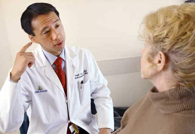 Dr. Frank Lin speaking with patient