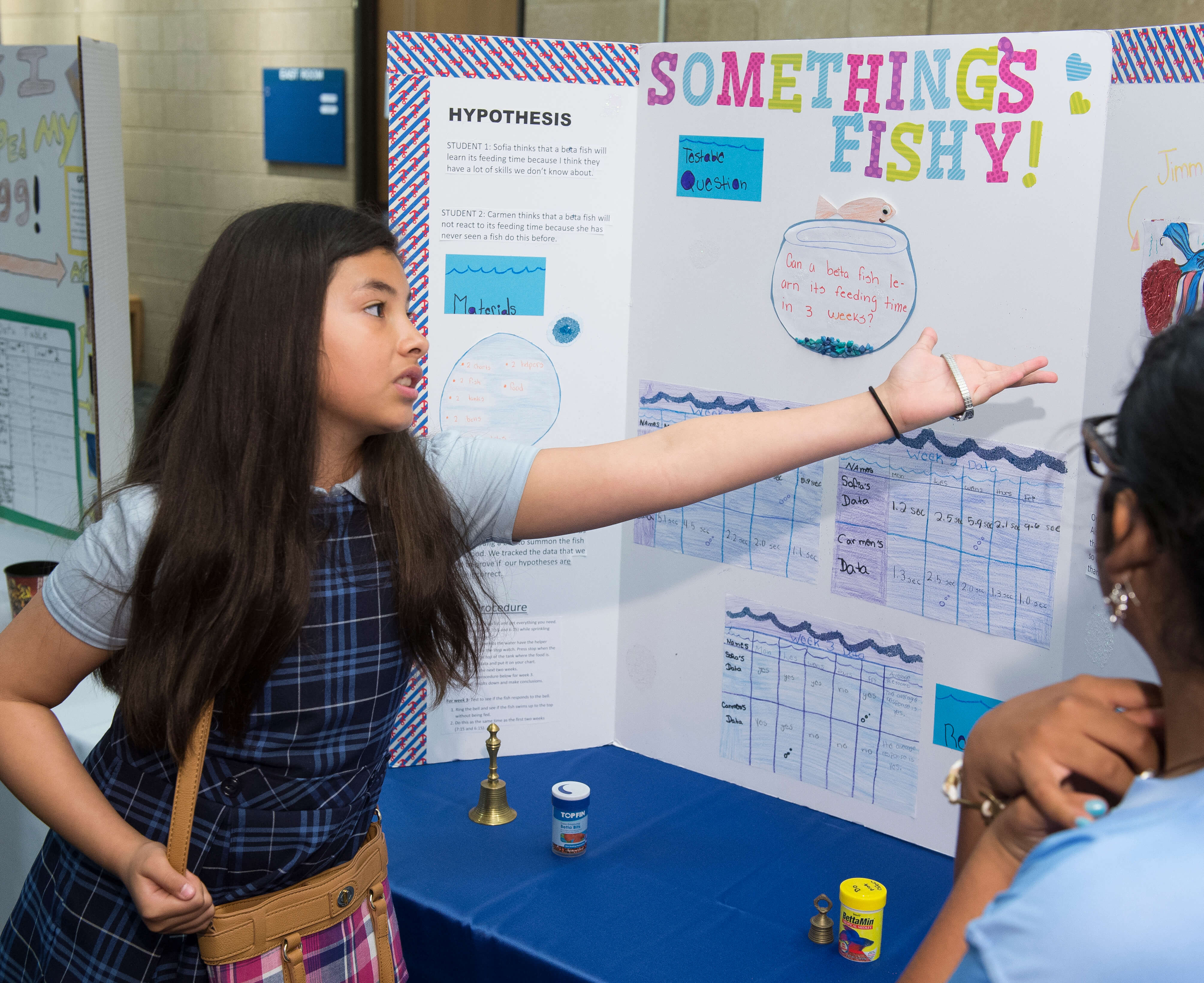 Girls present research at science fair.