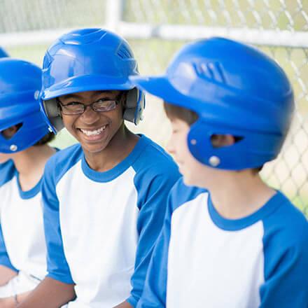 Kids in a baseball dugout