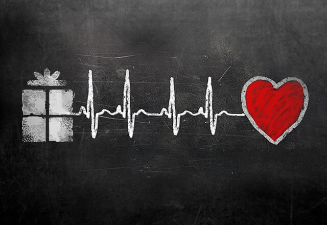 Illustration of a gift and a heart with a heart beat line between