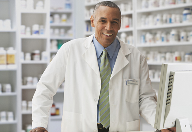 Pharmacist standing behind the counter