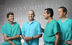 """I sometimes feel as though I've finished a good workout,"" says patient Josh Jordan, a year shy of his mega-surgery, ""but that's the only way I can tell anything happened.""  An elated Jordan recently traded tales of the OR with surgical team (L to R) Jean"