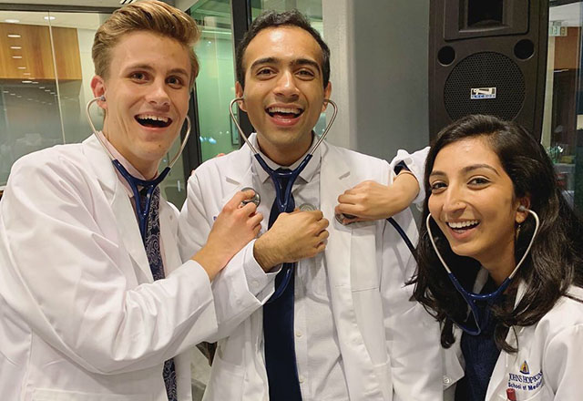 Laughing students with stethoscopes