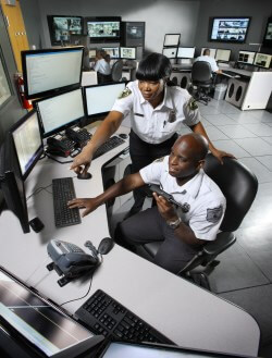 Security communications specialists Darlene Fairley and Jonathan Lewis keep their eyes on the security and safety of the East Baltimore campus.