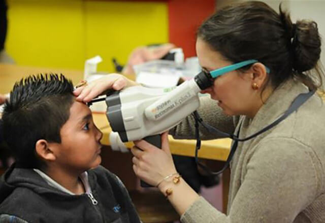 fitting school children for eyeglasses