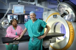 "Johns Hopkins Bayview's Neurosurgery Chair Alessandro Olivi, with nurse coordinator Allison Godsey. Says Olivi, ""This technology helps us verify positions and detect potential complications."""
