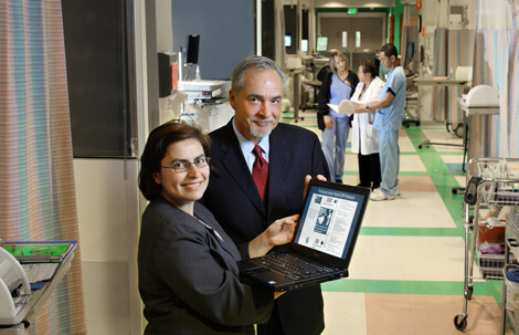 Hanan Aboumatar and Mark Cochran display a perioperative handoff protocol that Johns Hopkins is offering to other health care providers.