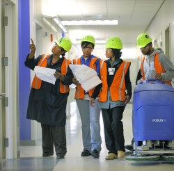 Environmental Services is one area that will expand staff as the size of the hospital complex doubles. Here Carole Johns, Sonia Stevenson, Charlene Partlow and Dameian Jones perform the first of two major cleaning and inspecting sessions on level 10 of th