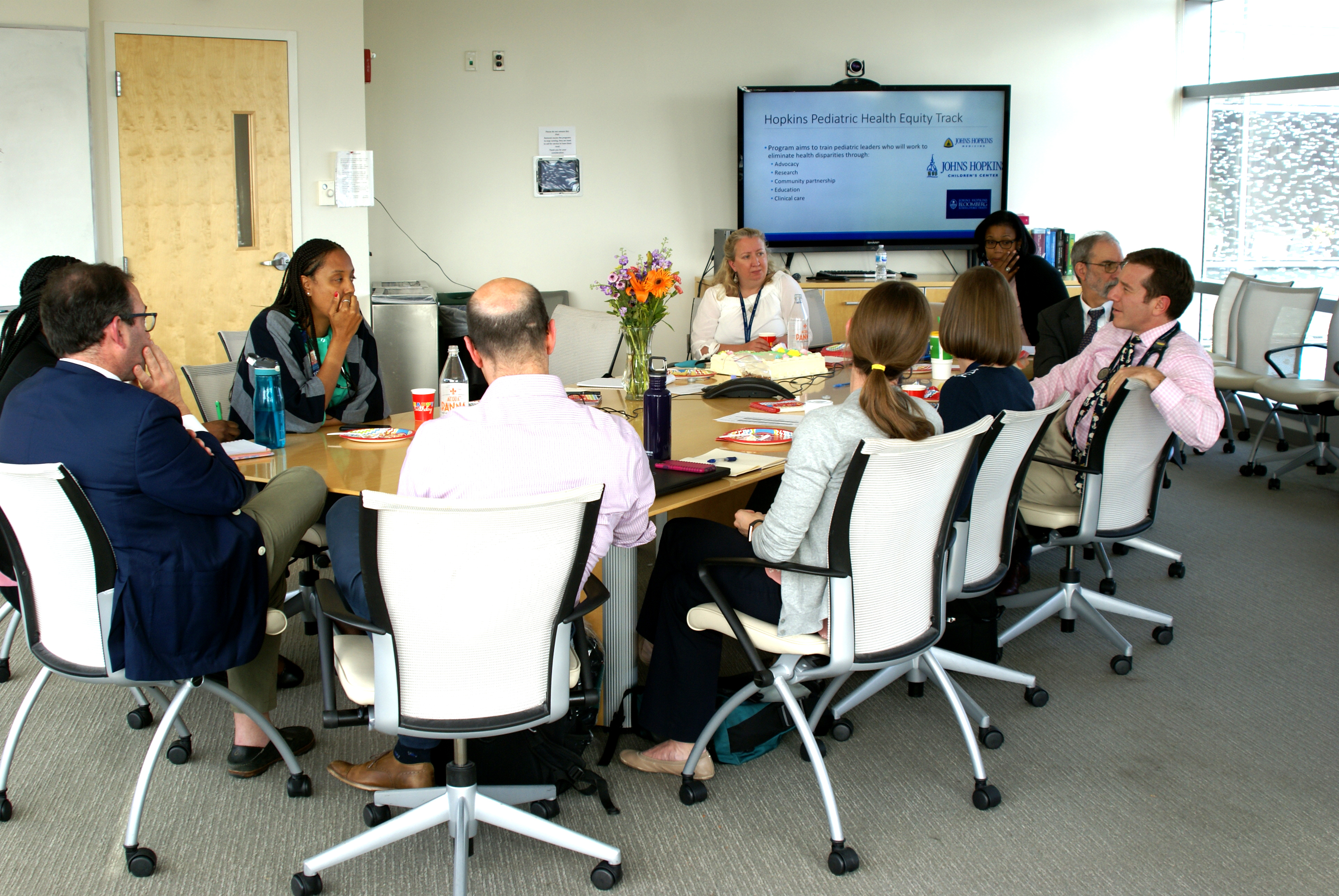 a group of pediatric professionals sitting in on a conference