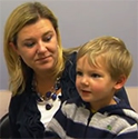 photo of Jack, Johns Hopkins craniosynostosis patient, with his mother