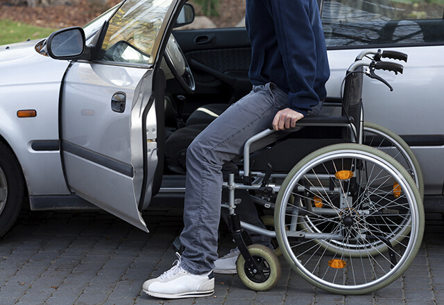 wheelchair patient at car