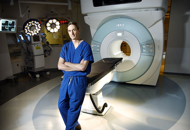 a surgeon in front of the intraoperative MRI machine