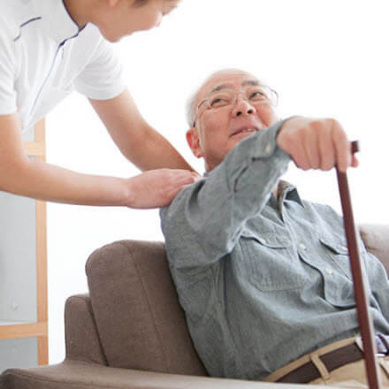 Caregiver assisting his father