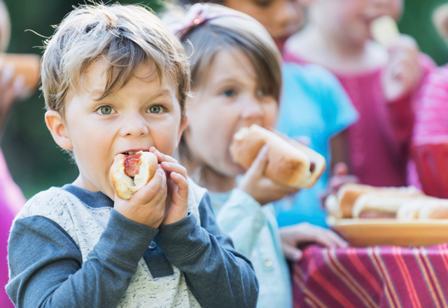 Image result for child eating hot dog
