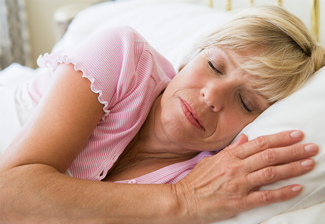 Woman sleeping on a hospital bed