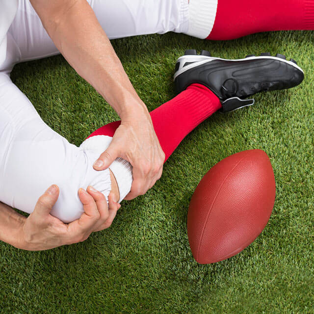Football player with a knee injury.