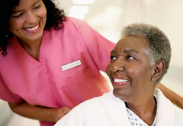 nurse smiling with elderly patient
