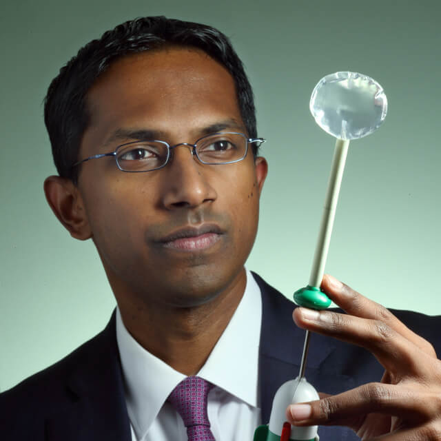 Orthopaedic shoulder surgeon Uma Srikumaran holding a subacromial balloon spacer