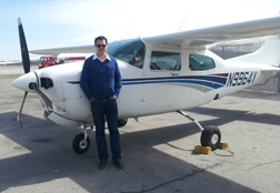 Frank Bosmans next to a Cessna airplane